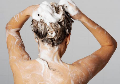 woman-washing-her-hair-with-shampoo